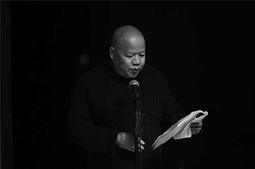 Chinese Poet Yu Jian is reading his poems on the Multiple Adaptations opening at TCG Nordica, Kunming